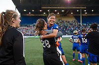 Seattle, WA - Saturday, July 02, 2016: Seattle Reign FC goalkeeper Haley Kopmeyer (28) celebrates Seattle Reign FC forward Nahomi Kawasumi's (36) return during a regular season National Women's Soccer League (NWSL) match between the Seattle Reign FC and the Boston Breakers  at Memorial Stadium.