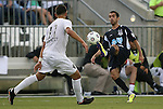 19 May 2012: Carolina's Austin da Luz (right) plays the ball away from PSA Elite's Christian Ramirez (17). The Carolina RailHawks (NASL) defeated the PSA Elite (USASA) 6-0 at WakeMed Soccer Stadium in Cary, NC in a 2012 Lamar Hunt U.S. Open Cup second round game.