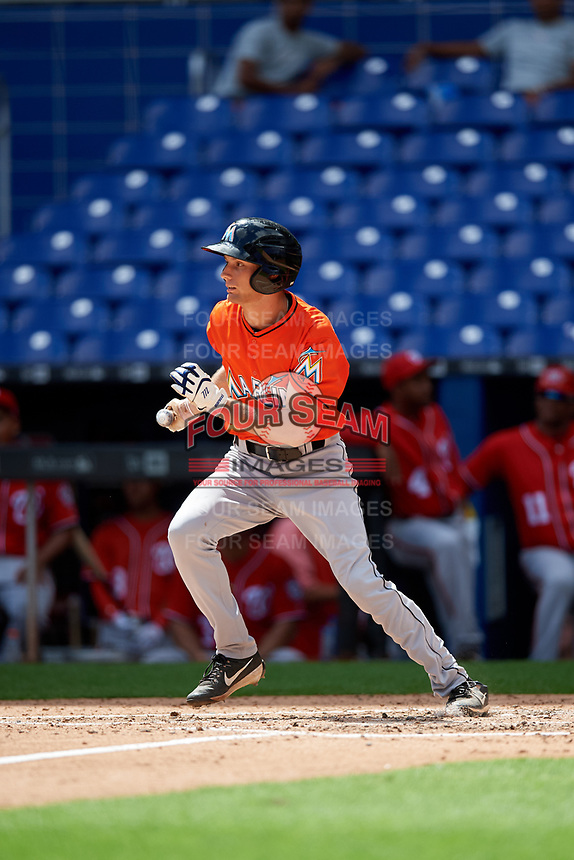 Miami Marlins Davis Bradshaw (52) follows through on a swing during a Florida Instructional League game against the Washington Nationals on September 26, 2018 at the Marlins Park in Miami, Florida.  (Mike Janes/Four Seam Images)