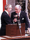 In this file photo dated January 6, 1987, the Speaker of the United States House of Representatives Jim Wright (Democrat of Texas), left, accepts the gavel from U.S. House Minority Leader Bob Michel (Republican of Illinois) just prior to being sworn-in as Speaker in the U.S. Capitol in Washington, D.C.  Wright passed away at age 92 on May 6, 2015.<br /> Credit: Arnie Sachs / CNP