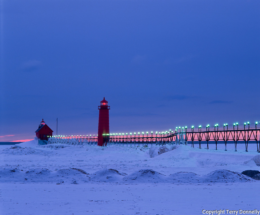 Grand Haven State Park, MI   <br /> Grand Haven Lighthouse in winter dusk light - red band of sky on the horizon
