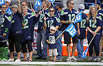 Seattle Seahawks 12th Man fans line the sidelines during pre game activities before their game against the Denver Broncos at CenturyLink Field in Seattle, Washington on  August 17, 2013. The Seattle Seahawks beat the Broncos 40-10.     ©2013. Jim Bryant Photo. All Rights Reserved.