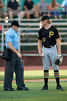 Bristol Pirates starting pitcher Shane Baz (10) talks with home plate umpire Kyle Stutz during a game against the Elizabethton Twins on July 28, 2018 at Joe O'Brien Field in Elizabethton, Tennessee.  Elizabethton defeated Bristol 5-0.  (Mike Janes/Four Seam Images)