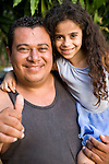 Nicaraguan father poses with his daughter, Isla de Ometepe, Nicaragua