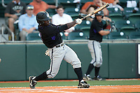 Central Arkansas Bears outfielder Jonathan Davis #3 connects during the NCAA baseball game against the Texas Longhorns on April 24, 2012 at the UFCU Disch-Falk Field in Austin, Texas. The Longhorns beat the Bears 4-2. (Andrew Woolley / Four Seam Images).