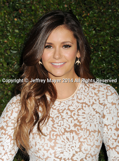 BEVERLY HILLS, CA- OCTOBER 02: Actress Nina Dobrev arrives at the Michael Kors Hosts Launch Of Claiborne Swanson Frank's 'Young Hollywood' Portrait Book at a private residence on October 2, 2014 in Beverly Hills, California.