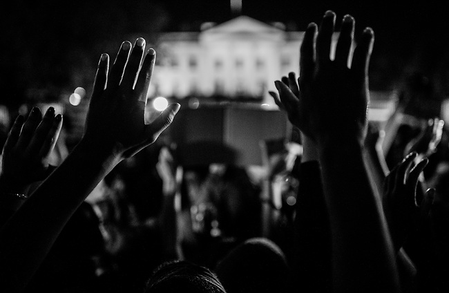 "Protesters chant ""hands up, don't shoot"" in front of the White House on Monday night, Nov. 24, 2014, following the announcement of no indictment in the shooting of Michael Brown in Ferguson, Mo."