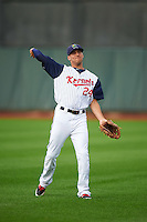 Cedar Rapids Kernels outfielder Zack Larson (24) warms up before a game against the Kane County Cougars on August 18, 2015 at Perfect Game Field in Cedar Rapids, Iowa.  Kane County defeated Cedar Rapids 1-0.  (Mike Janes/Four Seam Images)