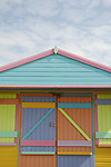 Bright multi pastel coloured beach hut and sky, Whitstable, Kent