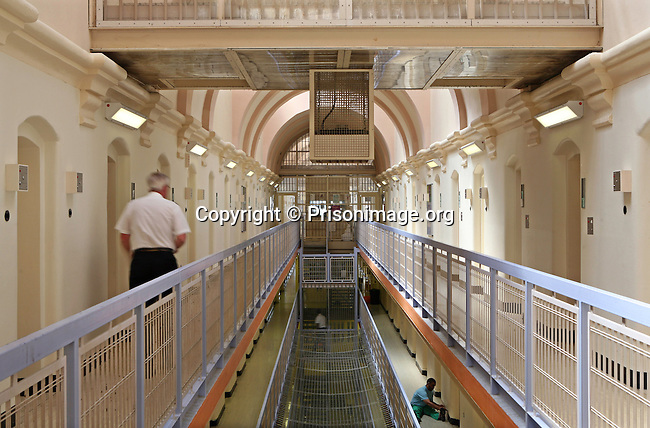 A prison officer walks down the C wing at Wandsworth prison..HMP Wandsworth in South West London was built in 1851 and is one of the largest prisons in Western Europe. It has a capacity of 1456 prisoners.