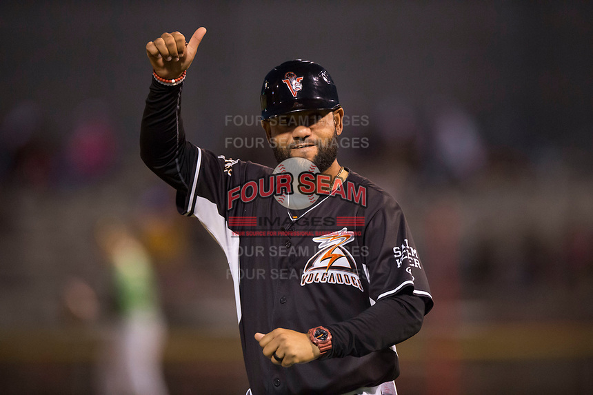 Salem-Keizer Volcanoes manager Hector Borg (13) during a Northwest League game against the Eugene Emeralds at Volcanoes Stadium on August 31, 2018 in Keizer, Oregon. The Eugene Emeralds defeated the Salem-Keizer Volcanoes by a score of 7-3. (Zachary Lucy/Four Seam Images)