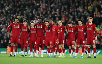 30th October 2019; Anfield, Liverpool, Merseyside, England; English Football League Cup, Carabao Cup, Liverpool versus Arsenal; the Liverpool players look on from the half way line during the penalty shoutout - Strictly Editorial Use Only. No use with unauthorized audio, video, data, fixture lists, club/league logos or 'live' services. Online in-match use limited to 120 images, no video emulation. No use in betting, games or single club/league/player publications