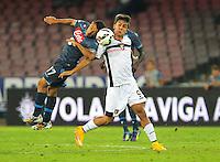 Walter Gargano  Paulo Dybala   durante l'incontro  di calco d Seriden A  tra SSC Napoli e US Palermo    allo stadio San Paolo di Napoli , 24 Settembre  2014