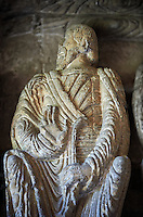 "Early Anglo Saxon sulpture of the an Apostle now part of the south porch of Malmesbury Abbey, Wiltshire, England. The apostles, apart from Peter who holds a crude key, have no distinguishing feature to allow identification. Some are holding books, none have halos and some hold their heads at awkward angles. These three styles are typical of Anglo Saxon art. The two panels are 10 ft long and 4ft 6"" high are date from the original Ango Saxon church of 705. They were probablbly built into the proch during the Norman rebuilding. The style of these sculptures is of the Roman Byzantine style and were probably sculpted by masions from Gaul.  Malmesbury Abbey, Wiltshire, England"