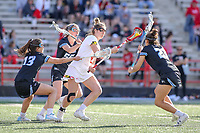 College Park, MD - April 27, 2019: Maryland Terrapins attack Kali Hartshorn (16) tries to avoid several John Hopkins Bluejays defenders during the game between John Hopkins and Maryland at  Capital One Field at Maryland Stadium in College Park, MD.  (Photo by Elliott Brown/Media Images International)