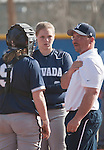 March 10, 2012:   Nevada Wolf Pack head coach Matt Meuchel talks with catcher Ashley Butera and pitcher Ariel Craig during their game against the Wisconsin Badgers played as part of the The Wolf Pack Classic at Christina M. Hixson Softball Park on Saturday in Reno, Nevada.