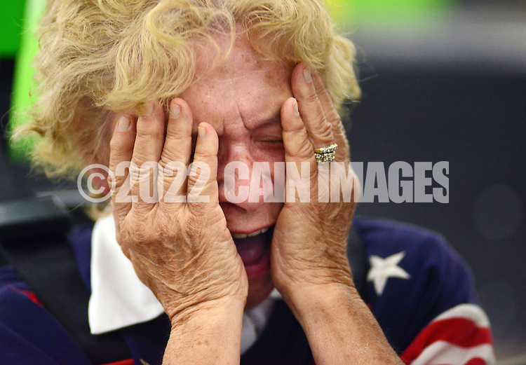 HORSHAM, PA - AUGUST 22: Mary Bodenstine, 76, of Folcroft, Pennsylvania reacts after winning the Granny Grampy Grand Prix at Speed Raceway August 22, 2014 in Horsham, Pennsylvania. Grandparents competed in electric go cart races to win a trip for four to Florida for the grandchild that entered them into the contest, which was sponsored by radio station WMMR. (Photo by William Thomas Cain/Cain Images)