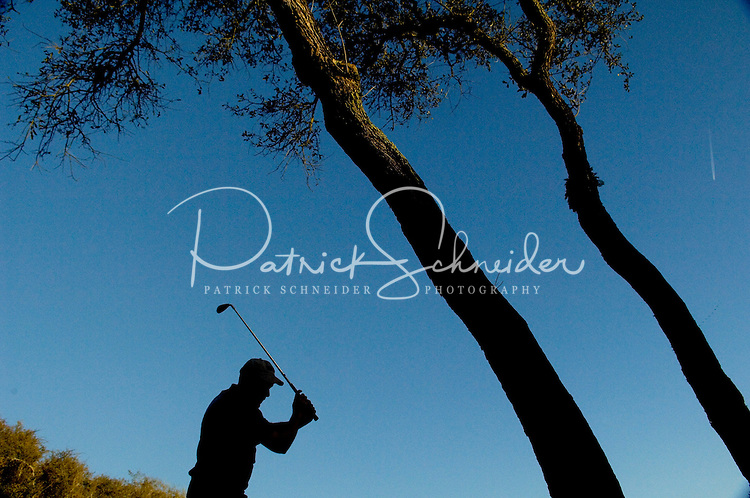 A golfer takes a practice swing in Amelia Island, FL