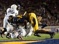 Chris McCain of California sacks Northwestern quarterback Trevor Siemian during the game at Memorial Stadium in Berkeley, California on August 31st, 2013.  Northwestern defeated CAL, 44-30.
