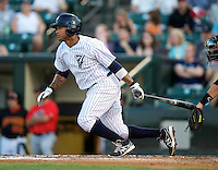 Empire State Yankees outfielder Darnell McDonald #5 at bat during a game against the Indianapolis Indians at Frontier Field on August 4, 2012 in Rochester, New York.  Empire State defeated Indianapolis 9-8 in ten innings.  (Mike Janes/Four Seam Images)