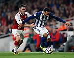 Arsenal's Sead Kolasinac tussles with West Brom's Matty Phillips during the premier league match at the Emirates Stadium, London. Picture date 25th September 2017. Picture credit should read: David Klein/Sportimage