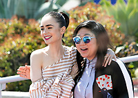 Lily Collins (L) and guest leave the photocall of the movie 'Okja' during the 70th Annual Cannes Film Festival at Palais des Festivals in Cannes, France, on 19 May 2017. - NO WIRE SERVICE · Photo: Hubert Boesl/dpa /MediaPunch ***FOR USA ONLY***