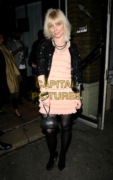 CHARLOTTE DUTTON .At The Best Of British Talent Party, Bar Music Hall, Shoreditch, London, England, UK, January 27th 2010..full length black jacket peach tights bag sequined sequin oral dress ruffles ruffle tiered .CAP/CAN.©Can Nguyen/Capital Pictures.
