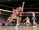 SIOUX FALLS, SD: MARCH 5: Jaycee Bradley #12 from the University of South Dakota drives to the basket against Ellie Brecht #34 from Nebraska Omaha during the Summit League Basketball Championship on March 5, 2017 at the Denny Sanford Premier Center in Sioux Falls, SD. (Photo by Dave Eggen/Inertia)
