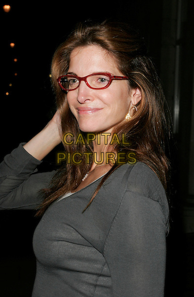STEPHANIE SEYMOUR.The Established & Sons Gallery Opening, London, England..October 11th, 2007 .half length grey gray top glasses .CAP/AH.©Adam Houghton/Capital Pictures.