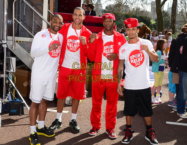 """Jonathan """"JB"""" Gill, Marvin Humes, Ortise Williams & Aston Merrygold of JLS.Sport Relief London Mile, The Mall, London- Charity fundraiser as part of Sport Relief weekend, London, England..March 25th 2012.full length white t-shirt red baseball cap hat shorts white adidas tracksuit medal .CAP/PP/JB.©Jane Burrows/PP/Capital Pictures."""