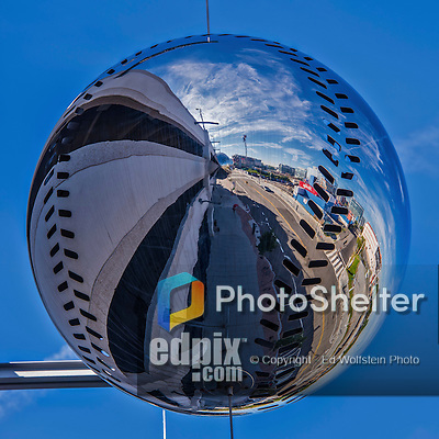 28 September 2014: Exterior View of a mirrored sculptural baseball element outside the Washington Nationals Parking Garage early in the day, prior to the last game of the regular season against the Miami Marlins at Nationals Park in Washington, DC. The Nationals shut out the Marlins 1-0, caping the season with the first Nationals no-hitter in modern times. The win also notched a 96 win season for the Nats: the best record in the National League. Mandatory Credit: Ed Wolfstein Photo *** RAW (NEF) Image File Available ***