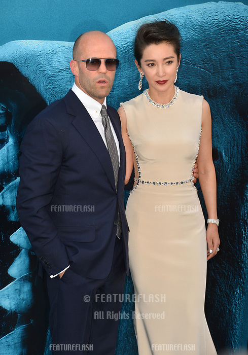 "LOS ANGELES, CA - August 06, 2018: Jason Statham & Li Bingbing at the US premiere of ""The Meg"" at the TCL Chinese Theatre"
