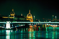 Lyon, France Rhone River, bridge and town lighted at night