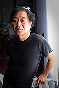 Japanese artist, Hitori Nakayama poses for a portrait in his studio in the UNESCO heritage city of Georgetown in Penang, Malaysia. Photo: Sanjit Das/Panos