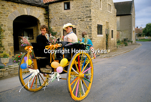 """""""MAYOR"""" & """"MAYORESS"""" (MAN DRESSES AS WOMAN) ON DECORATED CART, DURING PROCESSION AT KILBURN FEAST - BRITISH COUNTRY CUSTOMS, YORKSHIRE"""