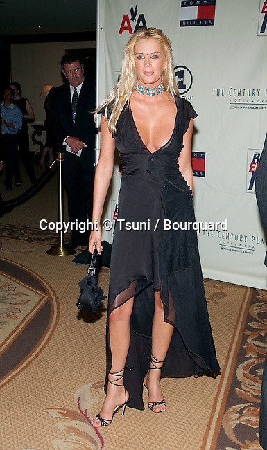 Kylie Bax arriving at the 9th Annual Race To Erase MS Gala: 'Peace and Love' at the Century Plaza Hotel in Los Angeles, Ca. Friday, May 10, 2002.  May 10, 2002.
