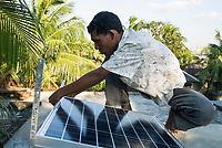 BANGLADESH , Sundarbans, village Burigoalinoi , micro-finance bank Grameen Shakti and NGO Srizony , promote micro-credit financed Solar Home Systems in villages