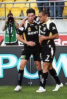 Troy Hearfield congratulates Leo Bertos for scoring the first goal during the A-League match between Wellington Phoenix and Newcastle Jets at Westpac Stadium, Wellington, New Zealand on Sunday, 4 January 2009. Photo: Dave Lintott / lintottphoto.co.nz