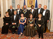 The five recipients of the 2014 Kennedy Center Honors pose for a group photo following a dinner hosted by United States Secretary of State John F. Kerry at the U.S. Department of State in Washington, D.C. on Saturday, December 6, 2014.  From left to right top row: David M. Rubenstein, Chairman of the John F. Kennedy Center for the Performing Arts; actor and filmmaker Tom Hanks; singer-songwriter Sting; singer Al Green; Michael Stevens, writer and producer of the annual Kennedy Center Honors; and George Stevens, Jr., producer of the annual Kennedy Center Honors.  From left to right, bottom row: Deborah F. Rutter, President of the John F. Kennedy Center for the Performing Arts; United States Secretary of State John F. Kerry; ballerina Patricia McBride; comedienne Lily Tomlin; and Teresa Heinz Kerry, wife of Secretary Kerry.<br /> Credit: Ron Sachs / Pool via CNP