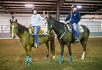 """NWA Democrat-Gazette/CHARLIE KAIJO Riley Harper of Springdale (from left) pets Whiskey, an outcrop paint horse, belonging to Savanah Crites of Highfill, Sunday, March 25, 2018 at the Benton County Fairgrounds in Bentonville. <br /><br />The Benton County Fairgrounds partnered with the Northwest Arkansas Horse Show Association to provide an arena for riders to bring their horses. <br /><br />""""This is a testing the waters kind of thing. WeÕd like to do more of these open ride events, enjoy the fairgrounds and the nice arena,"""" said Susan Koehler, fair and events manager of the Benton County Fairgrounds. """"Especially like today's rainy day. This is an opportunity for them to ride.""""<br /><br />The next event is on April 14. It will include a large horse show with barrel racing, pole bending speed events and an open horse show with judged events like English, Western Pleasure and Ranch Horse events."""