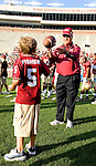 Florida State head coach Bobby Bowden pitches football with coach Jimbo Fisher's son during warm-ups prior to their Garnet and Gold game on Bobby Bowden Field on the Florida State University campus in Tallahassee, Florida April 4, 2009..(Mark Wallheiser/TallahasseeStock.com)