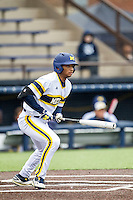 Michigan Wolverines outfielder Johnny Slater (25) follows through on his swing against the Bowling Green Falcons on April 6, 2016 at Ray Fisher Stadium in Ann Arbor, Michigan. Michigan defeated Bowling Green 5-0. (Andrew Woolley/Four Seam Images)