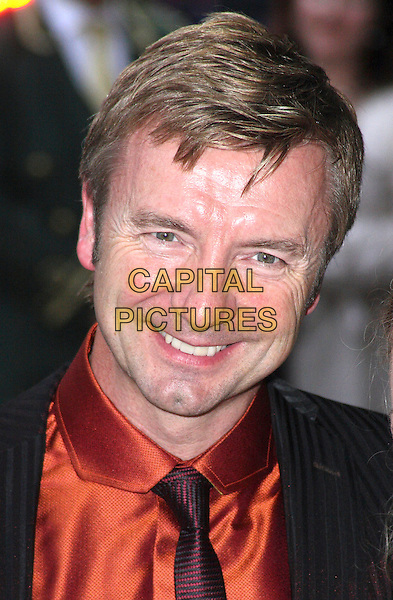 CHRISTOPHER DEAN .Arrivals for the Harper's Bazaar Women of The Year Awards at the Dorchester Hotel, Park Lane, London, England, September 7th 2009..portrait headshot red orange shirt tie shiny .CAP/JIL.©Jill Mayhew/Capital Pictures