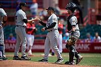 Akron RubberDucks manager Rouglas Odor (24) takes the baseball from pitcher Eli Morgan (35) for a pitching change as catcher Logan Ice (9) looks on during an Eastern League game against the Erie SeaWolves on June 2, 2019 at UPMC Park in Erie, Pennsylvania.  Akron defeated Erie 7-2 in the first game of a doubleheader.  (Mike Janes/Four Seam Images)