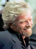 Virgin Atlantic Airways' Richard Branson enjoys a lighter moment during the United States Senate Commerce, Science and Transportation Subcommittee hearing on the U.S. - Britain aviation negotiations on June 4, 1997 in Washington, D.C.<br /> Credit: Ron Sachs / CNP