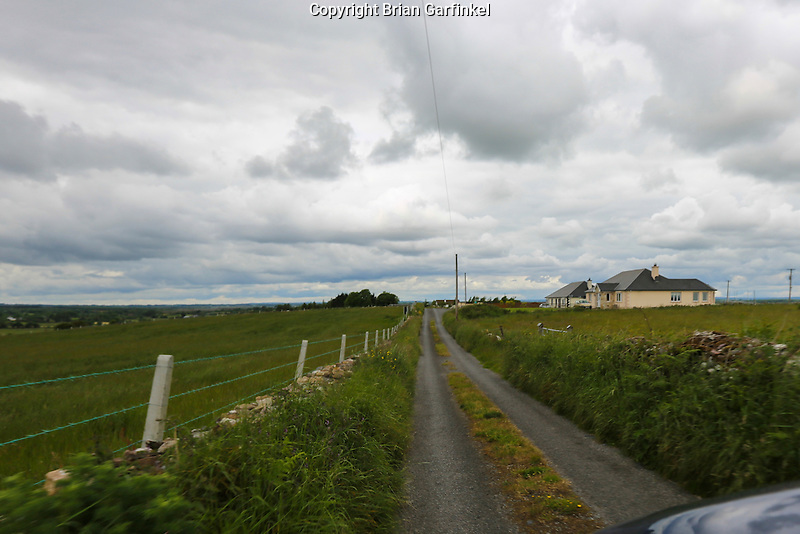 A small two way country road with grass on the middle of the roadway on our way to Granlahan, County Roscommon, Ireland on Tuesday, June 25th 2013. (Photo by Allison Garfinkel)
