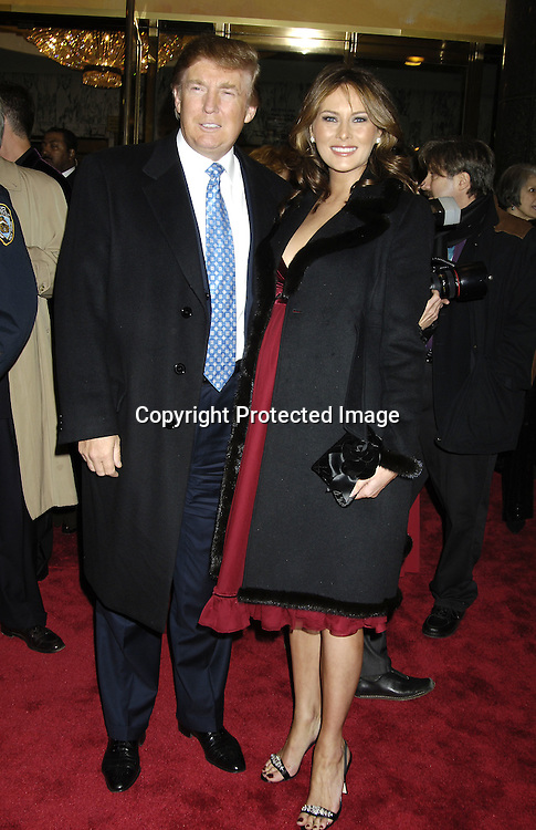 """Donald Trump and wife Melania ..arriving at the Broadway opening of """"The Color Purple"""" ..produced by Oprah Winfrey on December 1, 2005 ..at The Broadway Theatre...Photo by Robin Platzer, Twin Images"""