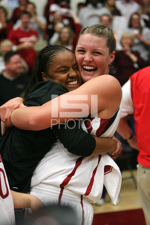 22 December 2007: Stanford Cardinal former basketball player Markisha Coleman (left) and Jayne Appel (right) during Stanford's 73-69 overtime win against the Tennessee Lady Volunteers at Maples Pavilion in Stanford, CA.
