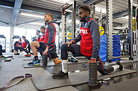 Mike van der Hoorn (C) and Nathan Dyer (R) exercise in the gym during the Swansea City Training at The Fairwood Training Ground, Swansea, Wales, UK. Thursday 11 January 2018