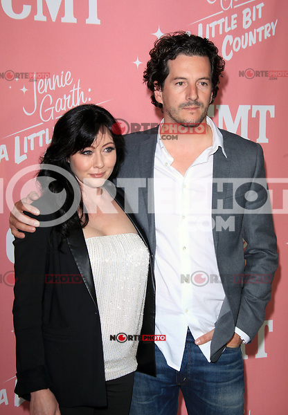Shannen Doherty and Kurt Iswarienko at Jennie Garth's 40th birthday celebration and premiere party for 'Jennie Garth: A Little Bit Country' at The London Hotel on April 19, 2012 in West Hollywood, California Credit: mpi20/MediaPunch Inc.